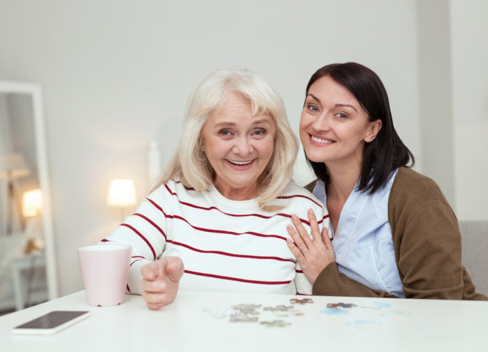 adult and senior woman smiling